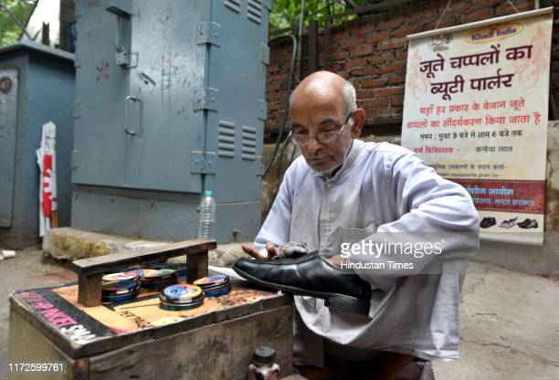 Kanhaiya Lal a cobbler and shoe shine at work near LIC building on the Parliament Street on September 30 2019 in New Delhi India Lal was assisted in...