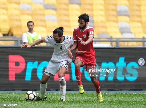 Kanischka Taher of Afghanistan and Hatem Sultan Abdallah Said Al Rushadi of Oman in actionduring the Airmarine Cup match between Oman and Afghanistan...