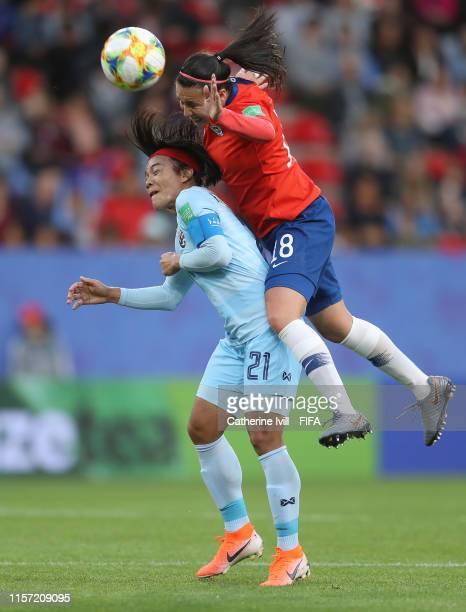Kanjana SungNgoen of Thailand competes for a header with Camila Saez of Chile during the 2019 FIFA Women's World Cup France group F match between...
