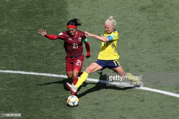 Kanjana Sung-Ngoen of Thailand is challenged by Caroline Seger of Sweden during the 2019 FIFA Women's World Cup France group F match between Sweden...