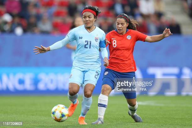 Kanjana SungNgoen of Thailand is challenged by Karen Araya of Chile during the 2019 FIFA Women's World Cup France group F match between Thailand and...