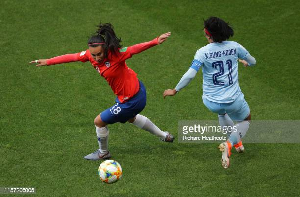 Kanjana SungNgoen of Thailand puts Camila Saez of Chile under pressure during the 2019 FIFA Women's World Cup France group F match between Thailand...