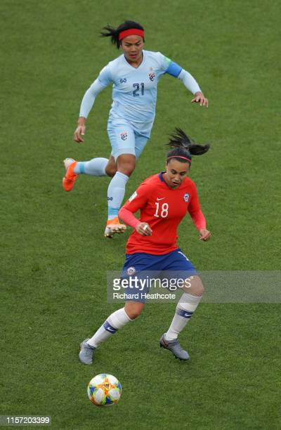 Kanjana SungNgoen of Thailand puts pressure on Camila Saez of Chile during the 2019 FIFA Women's World Cup France group F match between Thailand and...