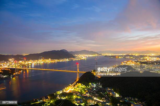 kanmonkyo bridge over kammon strait at night - 山口県 ストックフォトと画像