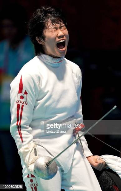 Kanna Oishi of Japan celebrates after competing against Youngmi Kang of Korea during the Women's Epee Individual Quarterfinals of fencing event on...
