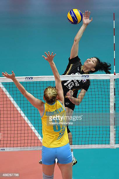 Kannika Thipachot of Thailand spikes as Korinna Ishimtseva of Kazakhstan blocks during the FIVB Women's World Championship pool C match between...