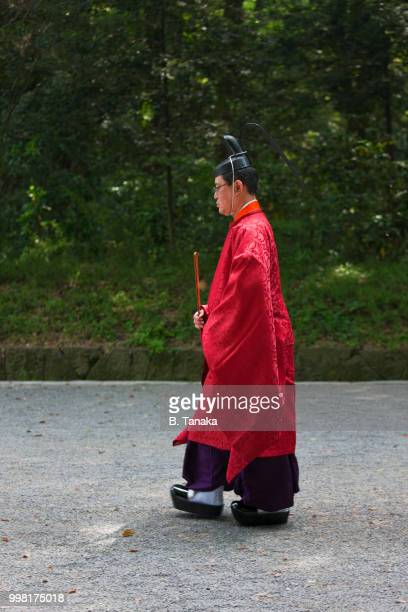 Kannushi Priest in Ceremonial Robes at Sacred Meiji-Jingu Shrine in Tokyo, Japan