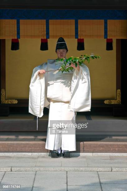 Kannushi Priest with Purifying Sakaki Branch at Sacred Meiji-Jingu Shrine in Tokyo, Japan