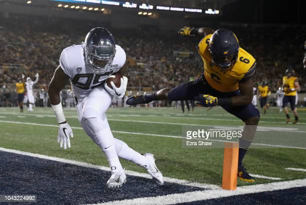 Kano Dillon of the Oregon Ducks goes past Jaylinn Hawkins of the California Golden Bears to score a touchdown at California Memorial Stadium on...