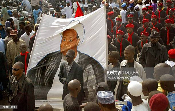 Black-shirted followers of a hardline Shiite Muslim sect carry a banner depicting Ibrahim Zakzaky, a Nigerian Shiite radical who wants to set up an...