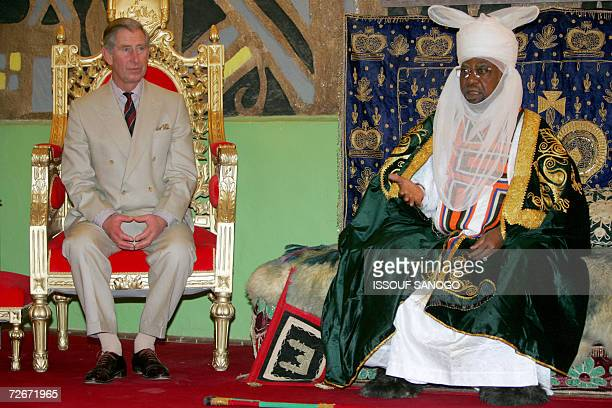 Britains Prince Charles listens to the Emir of Kano Ado Bayero in Kano 29 November 2006 Britains Prince Charles received a warm welcome in the...