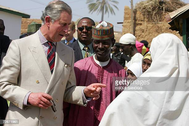 Britain?s Prince Charles speaks with a student at a Coranic school, in Kano, 29 November 2006. Britain?s Prince Charles received a warm welcome in...