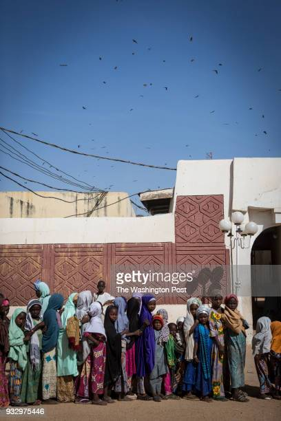 Kano Nigeria Girls wait in line to receive alms after Friday prayers in Kano Nigeria on Friday January 19 2018