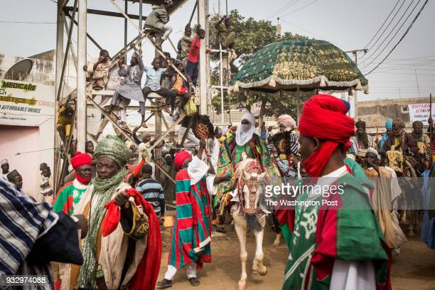 Kano Nigeria The Emir of Kano Muhammed Sanusi II surrounded by his guards and aides rides his horse to the Fatahul Mubin Islamic School graduation...