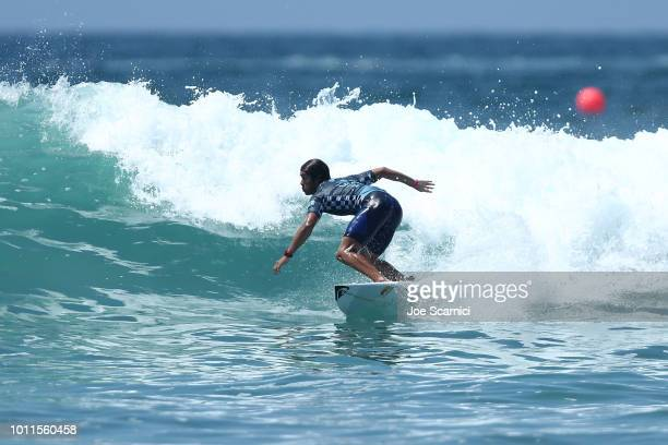 Kanoa Igarashi competes against Seth Moniz in their quarterfinal heat at the Vans US Open of Surfing on August 5 2018 in Huntington Beach California
