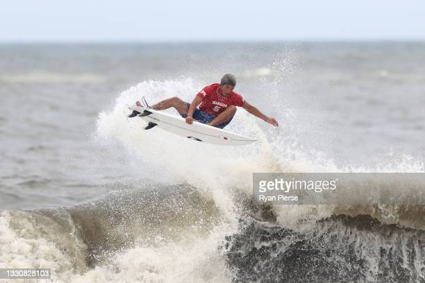 Kanoa Igarashi of Team Japan completes a huge aerial to find a last minute winning score against Gabriel Medina of Team Brazil during the men's semi...