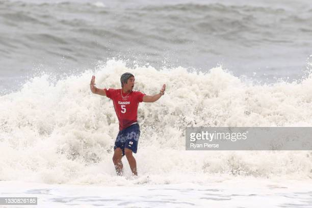 Kanoa Igarashi of Team Japan shows emotion after riding a wave during his mens's semi final on day four of the Tokyo 2020 Olympic Games at...