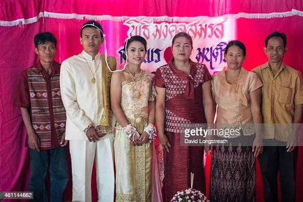 Kanokporn and Montri Thi pose for photographs wedding ceremonies in Ta Par Mok Thailand Thai Buddhist marriage ceremonies are generally divided into...