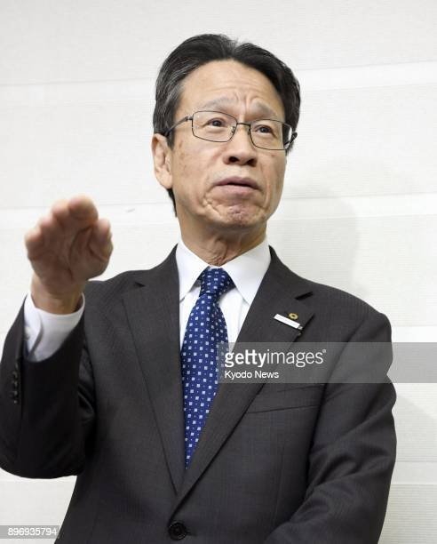 Kansai Electric Power Co President Shigeki Iwane speaks to reporters in Fukui Japan on Dec 22 after meeting with Fukui Gov Issei Nishikawa The...