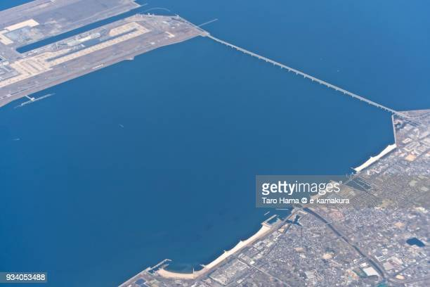Kansai International Airport in Izumisano city and beach in Sennan city in Osaka prefecture in Japan daytime aerial view from airplane