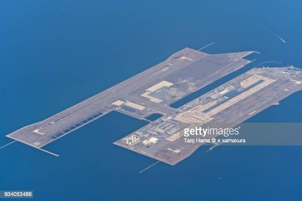 Kansai International Airport in Izumisano city in Osaka prefecture in Japan daytime aerial view from airplane