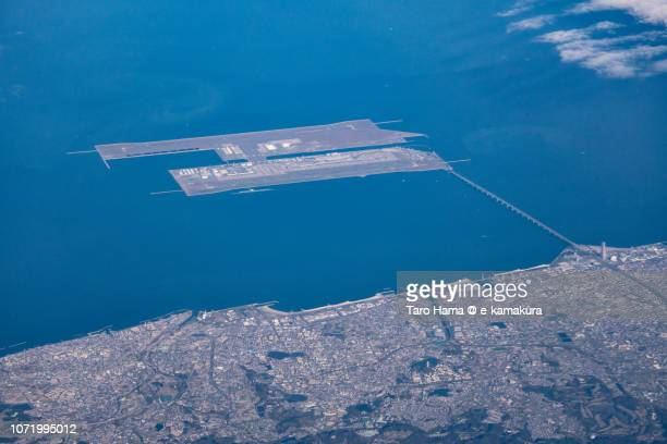 kansai international airport (kix) in osaka prefecture in japan daytime aerial view from airplane - region kinki stock-fotos und bilder