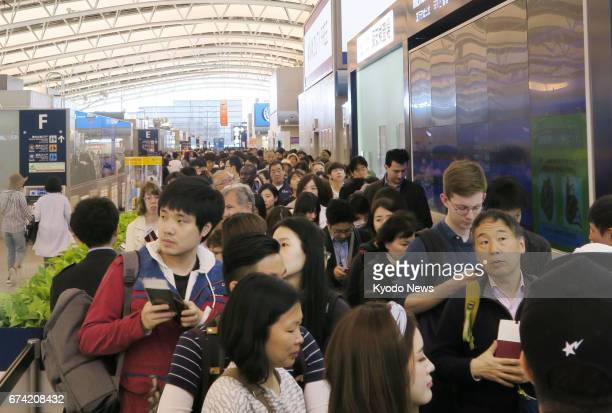 Kansai International Airport in Osaka Prefecture is flooded with travelers on April 28 as they prepare to spend Japan's 'Golden Week' holidays...