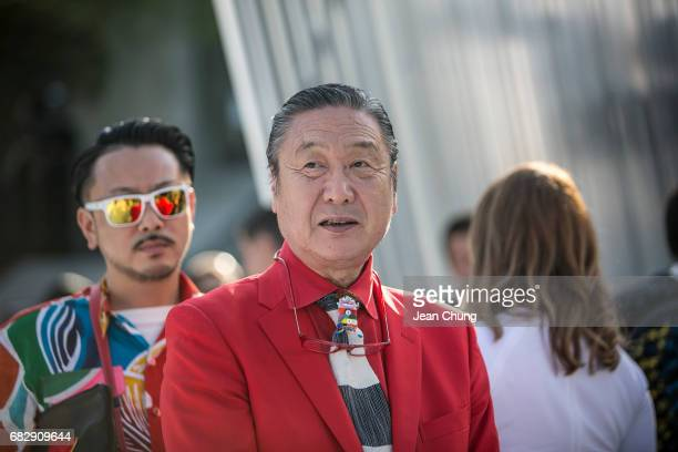 Kansai Yamamoto center attends the Louis Vuitton Resort 2018 show at the Miho Museum on May 14 2017 in Koka Japan