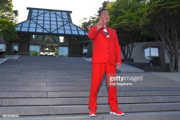 Kansai Yamamoto poses for photographs during the Louis Vuitton Resort 2018 show at the Miho Museum on May 14 2017 in Koka Japan