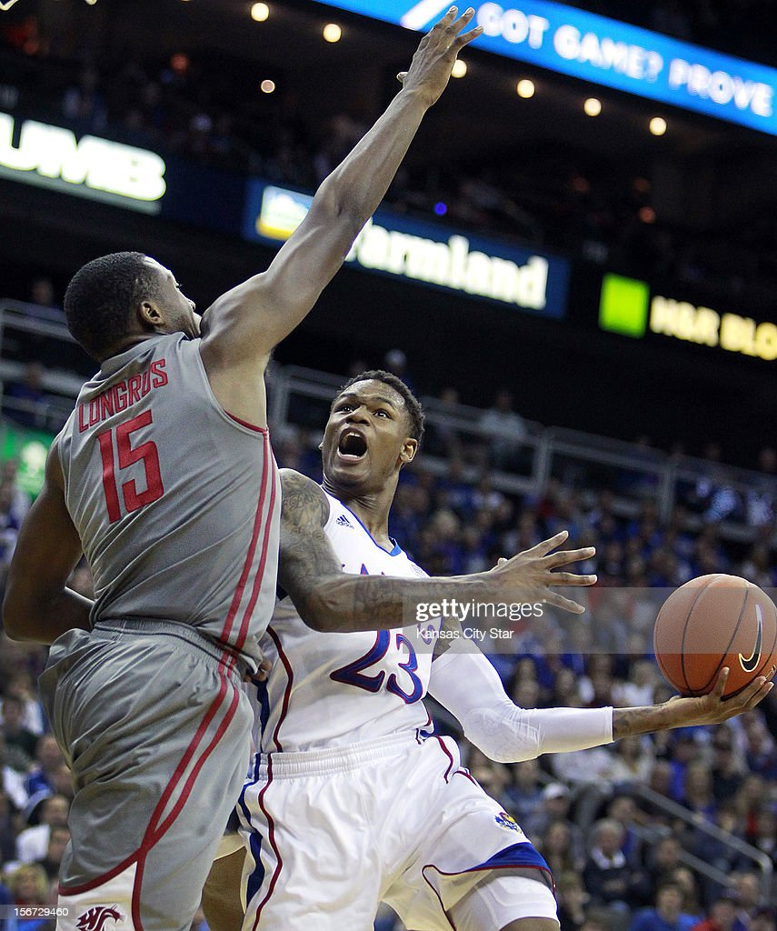Kansas' Ben McLemore drives against Washington State's Junior Longrus during the first half of the CBE Hall of Fame Classic at the Sprint Center on Monday, November 19, 2012, in Kansas City, Missouri.