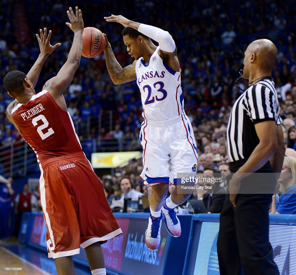 Kansas' Ben McLemore (23) plays a ball along the sidelines against Oklahoma's Steven Pledger in the first half at Allen Fieldhouse in Lawrence, Kansas, on Saturday, January 26, 2013. Kansas won, 67-54.