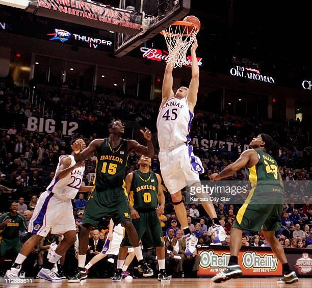 Kansas center Cole Aldrich tips in a basket as Kansas forward Marcus Morris Baylor center Mamadou Diene Baylor guard Curtis Jerrells and Baylor...