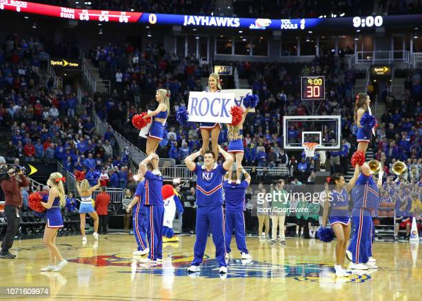 Kansas cheerleaders peform on center court before an NCAA basketball game between the New Mexico State Aggies and Kansas Jayhawks on December 8 2018...