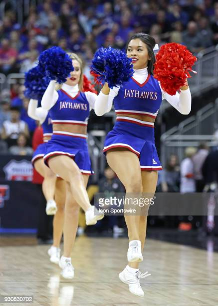Kansas cheerleaders perform in the first half of a quarterfinal game in the Big 12 Basketball Championship between the Oklahoma State Cowboys and...