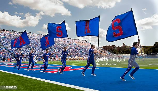 Kansas' cheerleaders ran around the field after the Jayhawks scored a touchdown in the fourth quarter against University of Southern Mississippi The...