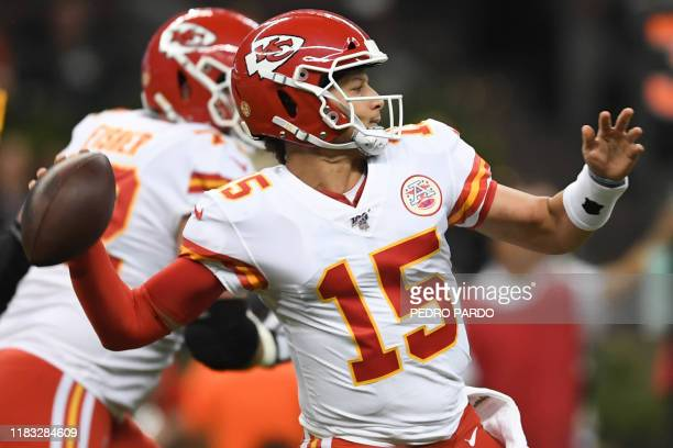 Kansas City Chief quarterback Patrick Mahomes prepares to throw during the 2019 NFL week 11 regular season football game between Kansas City Chiefs...