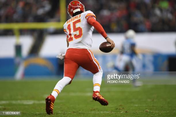 Kansas City Chief quarterback Patrick Mahomes runs with the ball during the 2019 NFL week 11 regular season football game between Kansas City Chiefs...