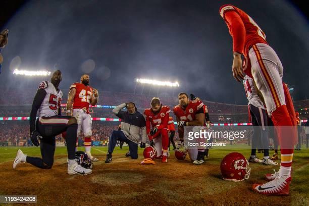 Kansas City Chiefs and Houston Texans come together center field for a prayer after the game on January 12 2019 at Arrowhead Stadium in Kansas City...