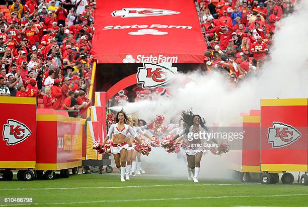 Kansas City Chiefs cheerleaders run out of the tunnel prior to the start of the game between the Chiefs and the New York Jets at Arrowhead Stadium on...