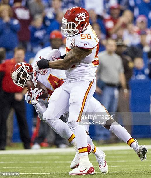 Kansas City Chiefs cornerback Brandon Flowers intercepts a pass against the Indianapolis Colts next to inside linebacker Derrick Johnson in the...