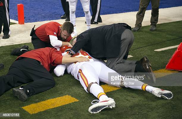 Kansas City Chiefs cornerback Brandon Flowers lays on the field after an Indianapolis Colts touchdown in the third quarter and was led off the field...