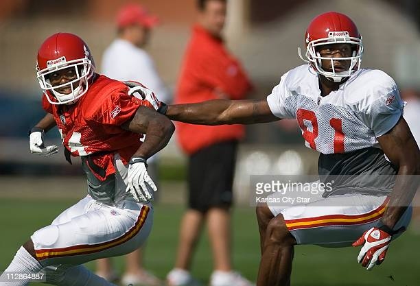 Kansas City Chiefs cornerback Brandon Flowers left gets a push from wide receiver Devard Darling right during drills on the campus of the University...