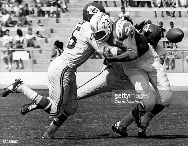Kansas City Chiefs cornerback Dave Grayson and safety Johnny Robinson break up a pass intended for San Diego Chargers running back Paul Lowe during a...