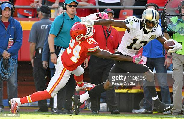 Kansas City Chiefs cornerback D.J. White pushes New Orleans Saints wide receiver Michael Thomas out of bounds at the eighth yard line on a first down...