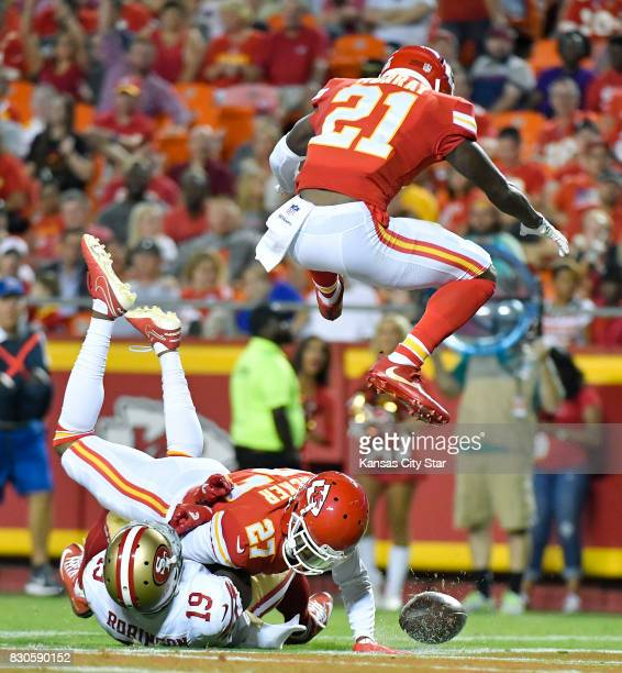 Kansas City Chiefs cornerback Kenneth Acker breaks up a pass intended for San Francisco 49ers wide receiver Aldrick Robinson as defensive back Eric...