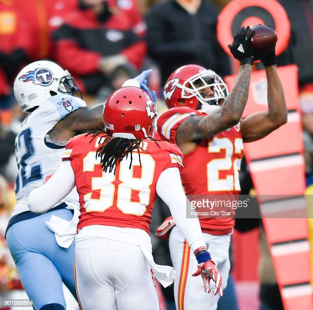Kansas City Chiefs cornerback Marcus Peters picks off a pass intended for the Tennessee Titans' Delanie Walker as Ron Parker helps on the coverage in...