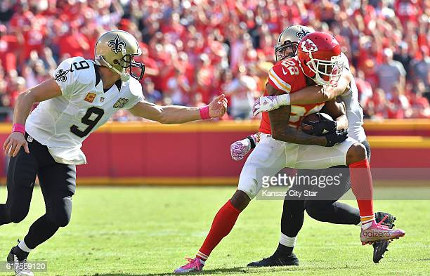 Kansas City Chiefs cornerback Marcus Peters runs through the arms of New Orleans Saints wide receiver Willie Snead after picking up a fumble by...