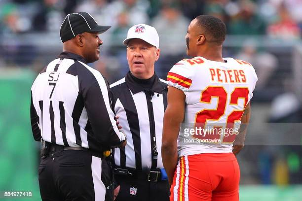 Kansas City Chiefs cornerback Marcus Peters talks with side judge Keith Washington and referee John Parry during the National Football League game...
