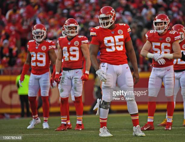 Kansas City Chiefs defenders defensive end Chris Jones cornerback Kendall Fuller defensive back Daniel Sorensen and linebacker Ben Niemann get set on...