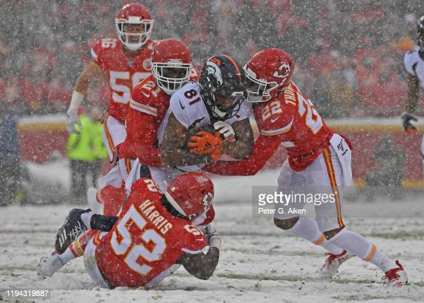 Kansas City Chiefs defenders free safety Juan Thornhill, defensive back Bashaud Breeland and linebacker Demone Harris tackle wide receiver Tim...